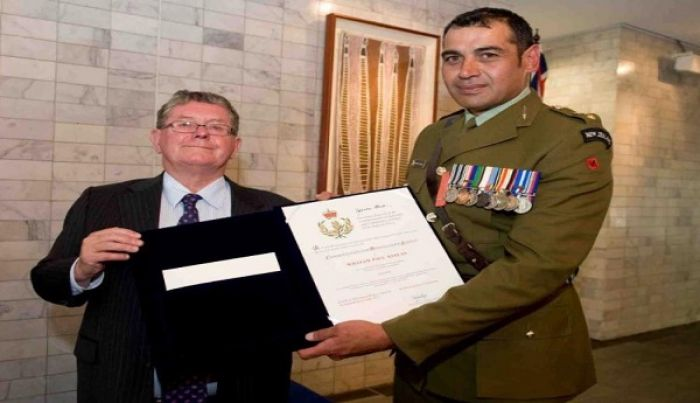 Lieutenant Colonel Bill Keelan the outgoing New Zealand Defence Forces Attache to Tonga has been presented with the Australian Defence Force's Commendation for Distinguished Service at the Australian High Commission in Wellington.
