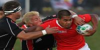 Sione Vaiomo'unga carries the ball for Tonga during pool game with Canada in the 2011 Rugby World Cup in New Zealand
